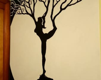 Woman in dance pose sillouette /tree in moonlight