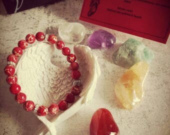 Reiki infused beaded stretch bracelet. Root/base chakra