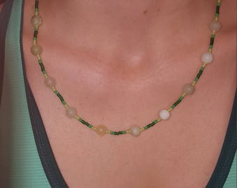 Green and white ceramic bead necklace.
