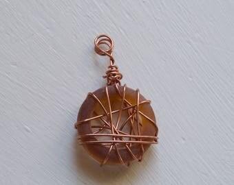 Copper wire wrapped brown seaglass pendant