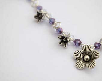 Glass and metal flower and leaf jewellery