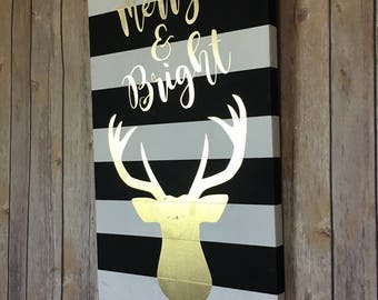 """Christmas Wood sign hand painted in stripes with """"Merry and Bright"""" and deer in gold."""
