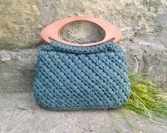 Crochet green handbag with plastic handles