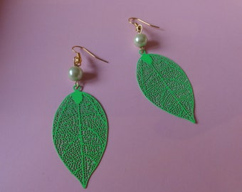 Mother of pearl beads and green filigree leaf earrings