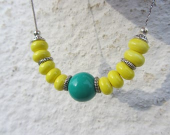 crew neck, bright shades of yellow and turquoise, Lampwork Glass rondelles, large round Pearl and serpentine silver chain