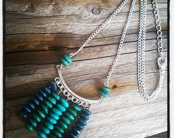 range of pendants in blue and turquoise wood beads and silver ethnic necklace