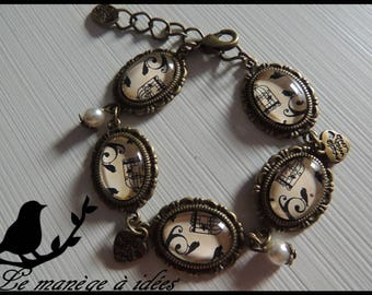 "Bronze bracelet adjustable cabochons romantic ""bird and cage""."