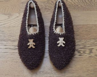 Indoor knitted hand accented with a wooden Teddy bear slippers