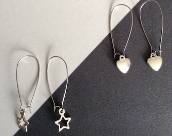 Two pairs of stud earrings with charms
