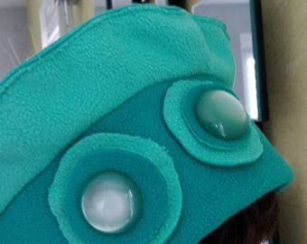 Watery green and blue fleece beret adorned with two buttons Pearlescent light green.