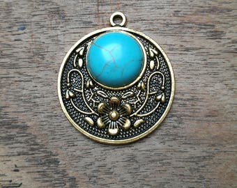 Blue turquoise colour Howlite pendant, golden brass, with flower detail.