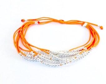Orange multi strand pearl bracelet