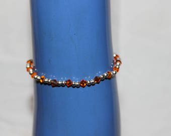 Orange and silver beaded bracelet