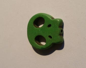 charm in the shape of skull Green