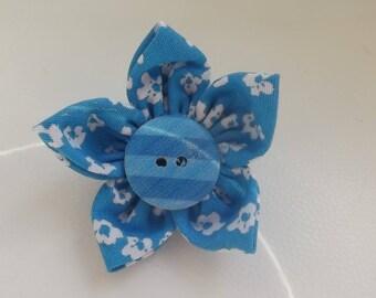 Blue fabric flower brooch.