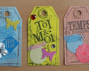 3 tags, 1 blue, 1 yellow and 1 fishing for your scrapbooking creations.