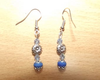 Blue earrings with a charm.