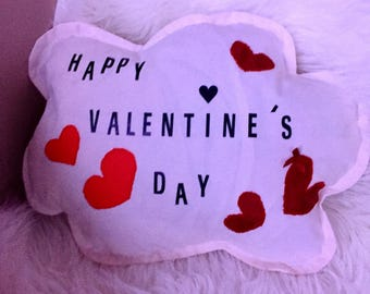 White cloud decorated with hearts pillow