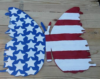 Handcrafted wooden butterfly, American flag design.