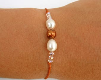 Discreet thin cord bracelet adorned with pearls and Crystal Swarovski ref beads: M005