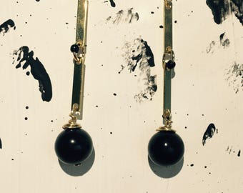 Gold/black earrings with rods