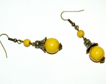 Canary yellow earrings and brass