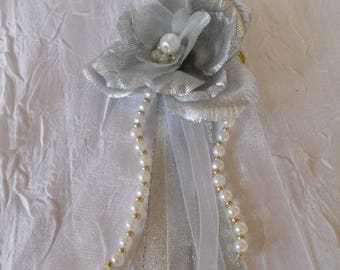 back train silver, brooch or boutonniere silver and white