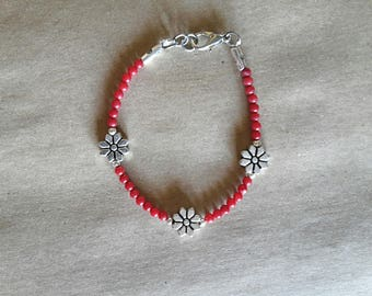 Handmade beaded bracelet with coral red hard stones and little fishes