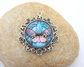 A pendant with glass Butterfly cabochon