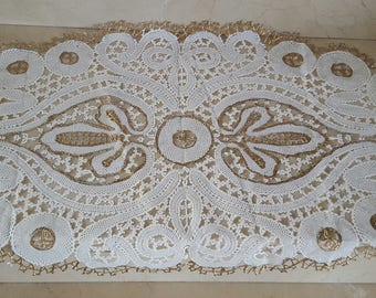 Ivory lace and gold oilcloth coupon