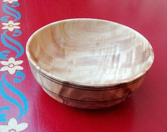 Bowl turned from eucalyptus food varnished wood.