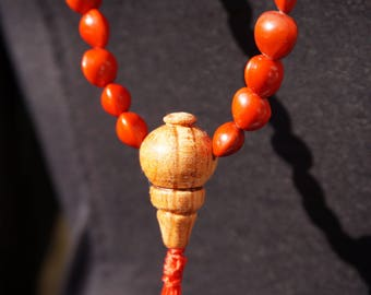 Buddhist mala with vegetal coral and wood