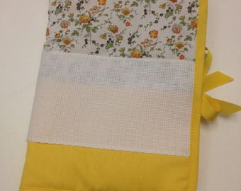 Health book has cross-stitch, yellow flowers