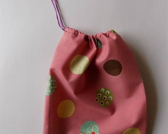 Pink purse amid colorful lozenges