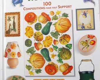 creative book with papers of decorated 100 compositions for support