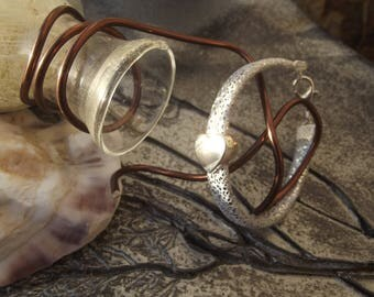 Kids bracelet light gray and silver leather with small silver heart shaped and silver clasp loop.