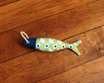 Keychain or decorative element in the shape of the fish