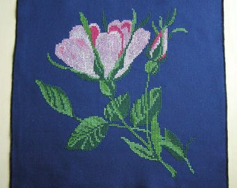 Embroidered roses on a Navy blue background