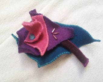 textile brooch made of wool felt and beads