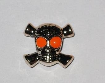 A large skull bead, eyes orange 1.5 cm