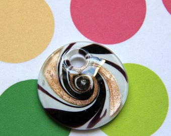 The round pendant black white and gold Murano style glass