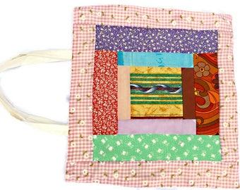 Beautiful patchwork shopping bag, lined with complimentary rose patterned fabric, and with a plain flower pattern on reverse.