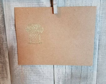 Jar of flowers embossed brown paper envelope