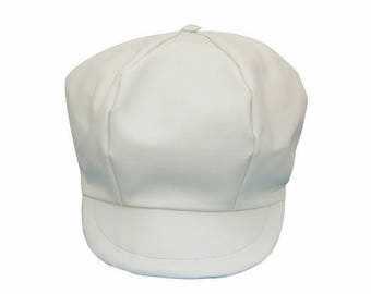 In cream white faux leather newsboy cap