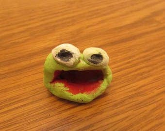 Baby clay frog