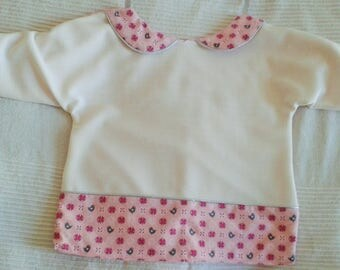 Bib with pink sleeves fully lined