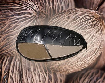 Small clutch with inner tube recycled leather zipper.