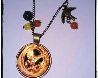 Hunger game orange and black necklace.