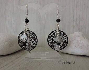 Dangling earrings black prints