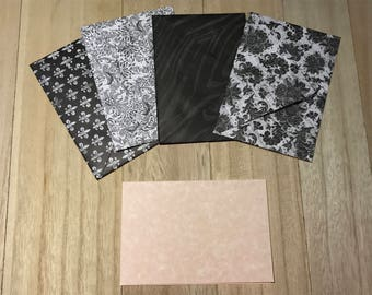 Black and white lined envelopes with notecards